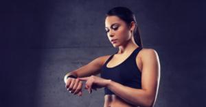 female athlete checking smart watch for digitalisation