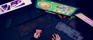 Hand holding credit card playing online gambling digital