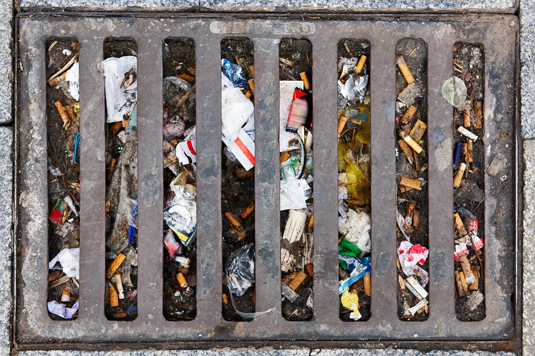 Sewer full of garbage. Urban pollution. Waste treatment. Clean cities. Digitisation is important