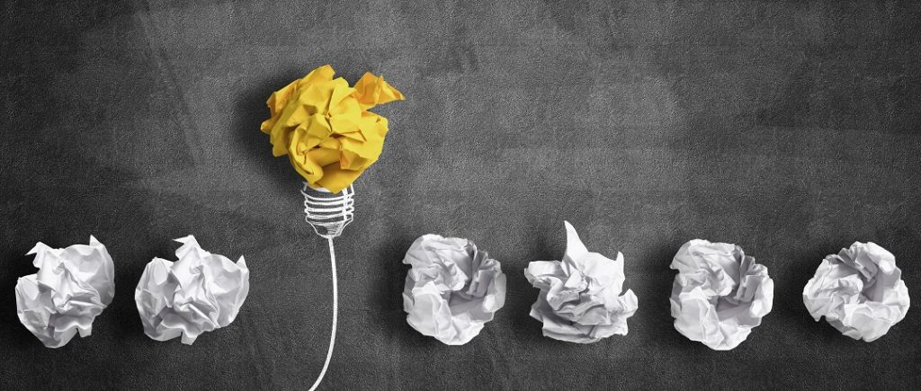 innovation concept with crumpled paper light bulb as good idea
