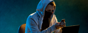 Cyber-Attacks hacker in hood